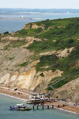Alum Bay (cybertect) Tags: sea cliff beach pier boat seaside sand isleofwight alumbay hurstcastle thesolent sonya7 canonfd200mmf40