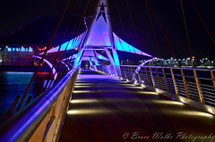 Pedestrian Bridge (Arizphotodude) Tags: longexposure nightphotography blue arizona lake landscape lights interestingness interesting nikon dusk rail railing nikkor tempe 2012 ariz pedestrianbridge tempetownlake d7k tempecenterforthearts d7000 nikond7000 brucewolke