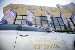 A VIP shuttle waits outside the Summit venue