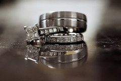 survived the day... (Morningdew Photography) Tags: blue wedding brown white toronto ontario canada black macro reflection closeup diamonds canon silver grey three dof bokeh gray ring diamond rings platinum weddingbands efl weddingband alienskin exposure4 morningdewphotography t1i