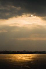 (Brnzei) Tags: sunset sky sun reflection ice water clouds frozen cloudy m42 murky manualfocus nightwatch goldenhour  bucureti laculmorii canoneos400d crngai soligor3570mmf2535mc kironprecision