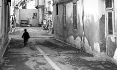 Child in North Nicosia (fede_gen88) Tags: street boy blackandwhite white black kid nikon europe capital border young cyprus running greenline nicosia forbiddenzone kbrs northerncyprus lefkoa turkishrepublicofnortherncyprus  d5100