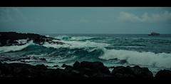 Hawaiian storm (joshmonk) Tags: ocean trip blue sea vacation sky people usa storm weather clouds boats outdoors 50mm hawaii coast spring nikon rocks surf waves unitedstates ships windy overcast northamerica nikkor 2014 choppy d7000 f18g f18g50mm