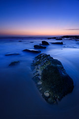 Curves (Rodney Campbell) Tags: ocean longexposure sky lightpainting water sunrise rocks au australia newsouthwales cpl whalebeach gnd09