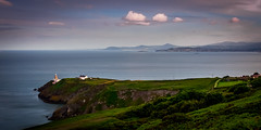 Bailey Lighthouse Howth (davidjhumphries) Tags: ocean blue ireland sunset sea sky howth dublin cliff lighthouse green eye nature rock clouds canon golden bay harbor boat glow harbour dusk wide vista 5d irelands 1740mm gorse 2016 waater 0616 5dmkii 270616