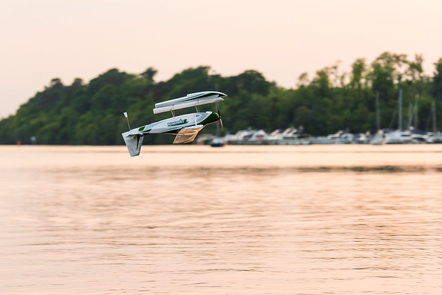 Phil inverted with the Tundra low over the water.