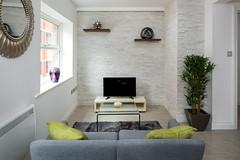 Basinghall Lounge (robcrawshawphoto) Tags: england green design tv flat interior property sofa tiles cushions neutral