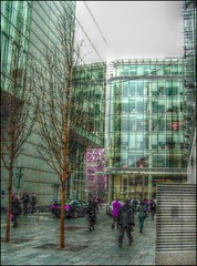 Pedestrians in Clover (Lammyman) Tags: life city england urban colour geometric glass face lines architecture modern buildings manchester britain geometry library silk angles manipulation shades retro lancashire hues greater innercity salford tones edit sheer tints glasstile rylands photoscape ipiccy