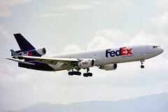 N591FE McDonnell Douglas MD-11(F) FedEx Federal Express KIX 12JUL01 (Ken Fielding) Tags: n591fe mcdonnelldouglas md11f fedex federalexpress aircraft airplane jet trijet cargo freighter widebody