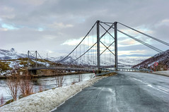 Bridge (Daniel J. Mueller) Tags: road bridge snow mountains norway clouds bush steel hdr senja 7xp d3s