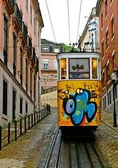 Gloria lift (pedrosimoes7) Tags: portugal yellow graffiti lift lisbon transport vehicles cables trams elevador restauradores flickrduel elevadordaglória glorialift