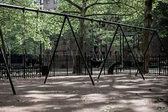 Swingset (wwward0) Tags: nyc trees black playground manhattan frame amsterdamave wwwardcamera2