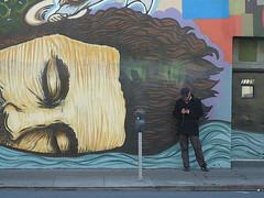 A01101 / two men (janeland) Tags: sanfrancisco california sleeping man person mural streetscene sidewalk 94103 texting howardstreet
