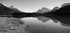 Meditation (CNorthExplores) Tags: travel autumn bw white lake canada black mountains reflection water canon alberta banffnationalpark g11 canadianrockies explored