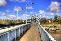 constructed 1897 (Tony Shertila) Tags: blue england sky water weather clouds river iron europe day crossing cloudy britain engineering swing lincolnshire wash fens hdr nene girder eastanglia southholland suttonbridge crosskeysbridge armstrongwhitworth