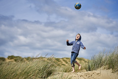 Eye On The Ball (ReportageImages) Tags: boy portrait eye beach ball football sand candid sony dune 85mm on the gmaster a7rii