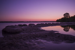 Another World (Moustafa Kzaiha) Tags: world longexposure sunset sky reflection tree nature water silhouette germany sand rocks purple sony calm le sunsetlight a7