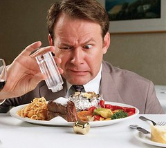 Too Much Salt on Food --- Image by  Stanley Fellerman/Corbis (marcusvinicius441) Tags: people food male men dinner one dish adult accident beef plate vegetable meat container indoors steak meal produce abundance disappointment pouring disgust seasoning oneperson bakedpotato mistakes beefsteak redmeat saltandpeppershakers preparedfood caucasianethnicity foodcontainer tablesalt cookedpotatoes