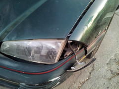 20150319 - Carolyn's car accident - smashed up Grand Am - driver's side front headlight - (by Carolyn) - 20150319_080253 (Rev. Xanatos Satanicos Bombasticos (ClintJCL)) Tags: light car maryland fender vehicle hanging hood headlight smashed 1994 silverspring caraccident totaled carhood 2015 pontiacgrandam camerapersoncarolyn pontiacgrandamcar pontiacgrandam1994 pontiacgrandam1994car 201503 20150319 caraccident20150319