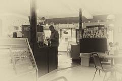 Mike, getting coffee (joeldinda) Tags: friends mike window work march nikon counter charlotte michigan interior shadowplay coffeehouse lightandshadow v2 2016 fays eatoncounty 3091 1v2 evelynbay nikon1v2 faysevelynbaycoffeeshop