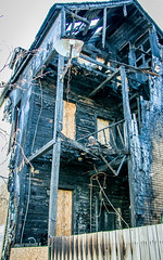 Back Porch (BradPerkins) Tags: house chicago building abandoned broken fire illinois apartment destruction empty debris burnt urbanexploration porch boardedup pillars destroyed burned urbanlandscape firedamage abandonedillinois