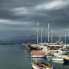 Drak clouds above Fethiye (VillaRhapsody) Tags: winter sea weather clouds dark boats harbor mediterranean fethiye