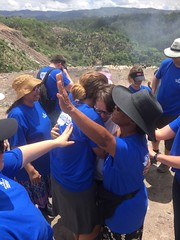 FPC missions team prays with translator 6/16/16