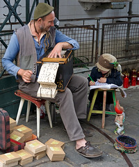 Street musician and child, Porto (Jimolin107) Tags: street musician portugal porto urchin barrelorgan budgierigar ogan