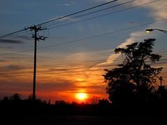 Underneath a sky that's ever falling down (frankieleon) Tags: sunset sky sun clouds interestingness interesting bestof cc powerlines wires creativecommons popular nightfall endofday frankieleon