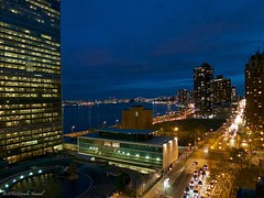 Dusk at the United Nations (CVerwaal) Tags: nyc newyorkcity newyork canon dusk un unitednations eastriver firstavenue canons100