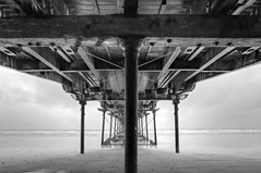 Under Saltburn Pier (mark_mullen) Tags: uk blackandwhite monochrome rain grey victorian structure metalwork underneath hdr northyorkshire canon1740f4 photomatix saltburnbythesea saltburnpier redcarandcleveland canon5dmk3 markmullenphotography
