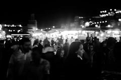 Marrakech - Place Jemma El Fna (aminefassi) Tags: africa street light portrait people blackandwhite bw copyright white black blanco night contrast dark lumix noir photographie place shot artistic retrato minaret arabic panasonic mai morocco portraiture maroc marrakech maghreb marrakesh foule schwartz blanc jamma moroccan 43 2012 lightroom  photographe fna  m43 mft marocaine marocain jemmaelfna morokko jamaelfna  marueccos gf3 retratto jammaelfna stphotographia microfourthirds 20mmf17 dmcgf3 aminefassi