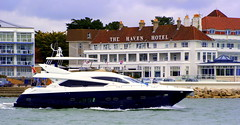 Posh in Poole (The Old Brit) Tags: sea water boats sailing rich maritime hotels nautical wealthy posh motoryacht sandbanks poole englishchannel wealth pooleharbour motorcruiser havenhotel canfordcliffscoastline britainspalmbeach