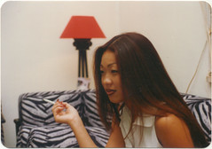 Asian Lady in her apartment, circa 1973 (STUDIOZ7) Tags: woman girl asian apartment cigarette smoking 1970s oriental smoker seventies