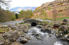 Ashness Bridge (AbhijeetVardhan) Tags: road bridge england mountain lake tourism water nikon rocks stream district derwent hill cumbria d90 ashness