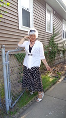Flirtacious Older Woman (Laurette Victoria) Tags: woman fence silver sweater skirt milwaukee cougar laurette