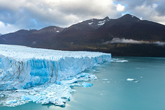 Perito Moreno Glacier (baddoguy) Tags: mountain lake ice water argentina horizontal outdoors photography nationalpark nopeople unescoworldheritagesite glacier copyspace awe majestic dramaticsky climatechange coo mountainrange morenoglacier deepsnow patagoniaargentina socialissues cloudsky traveldestinations famousplace losglaciaresnationalpark beautyinnature lakeargentina coldtemperature santacruzprovinceargentina