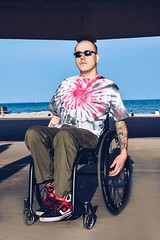 (KimberleySE) Tags: ocean charity uk blue boy sea summer portrait man hot green love beach beauty smart fashion portraits 35mm canon 50mm amazing interesting model nikon colorful europe flickr photoshoot wheelchair portraiture tiedye popular modelling inspiring malemodel classy disability 200mm wheelchairrugby d5300 wheelchairmodel