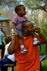 Joy (pretty-nifty) Tags: boy orange man shirt happy glasses dad ride father joy son enjoy papa shoulder stroll