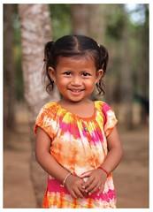 Beautiful smile. (the jacal) Tags: trees portrait smile cambodia khmer smiles olympus angkorwat temples tiedye siemreap zuiko 45mm bayon ep2 khmersmile epl2