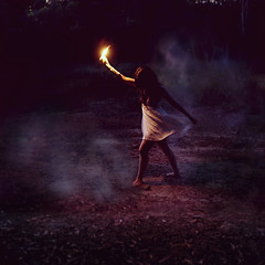 in the darkest of times (Ingrid Endel) Tags: light woman mist travelling art ingrid girl fog forest canon fire candle darkness wind path smoke fineart australia dancer flame torch squareformat figure wax strength brunette conceptual fineartphotography whitedress endel ingridendel inthedarkestoftimes