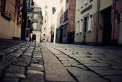 Klasztorna Street, An intimate encounter (ewitsoe) Tags: street closeup 50mm alley nikon view empty cobblestones poznan d80 playinginthesun