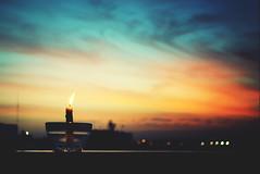 El Lmite (JavierAndrs) Tags: city light sunset sky color building luz colors clouds atardecer fire lights evening luces nikon candle dof view bokeh balcony edificio ciudad colores 55mm cielo nubes vista fuego vela crdoba balcn 56 pdc tardecita d3100