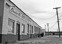 Cantrell's Body & Fender Shop (Vorona Photography) Tags: auto city urban usa beach car bicycle shop night america way grit photography lights evening photo washington highway automobile view state pacific northwest image body south united picture overpass gritty neighborhood fender photograph 99 repair works vehicle local tacoma states cruiser southtacomaway cantrells