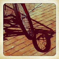 bike shadows (lucymagoo_images) Tags: shadow abstract brick philadelphia geometric bike bicycle wheel vintage square polaroid pattern shadows geometry patterns curves spokes tire bicicleta retro sidewalk round bici faux philly curved oval fauxlaroid lucymagoo lucymagooimages