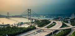 Tsing Ma Bridge - before the storm (dawvon) Tags: world life china city longexposure travel bridge urban hk ed hongkong nikon asia cityscape traffic zoom cloudy harbour photojournalism gear wideangle equipment highways metropolis nikkor  suspensionbridge vr afs newterritories lenses zoomlens mawan tsingmabridge f4g  photographyequipment 1635mm tsingyi cablestayedbridge  fmount vibrationreduction vr2 tingkaubridge  vrii photographygear wideanglezoom nanocrystalcoat afsnikkor1635mmf4gedvr 1635mmf4gvr