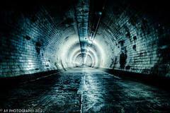 Beauty of the Beast (Aaron Yeoman [Old Account]) Tags: city uk greatbritain travel blue light england urban white reflection london lines architecture reflections dark underground subway tile vanishingpoint europe metro unitedkingdom empty sony low curves greenwich perspective railway tunnel gritty dirty line creepy tiles gb docklands alpha curve vignetting vignette hdr highdynamicrange isleofdogs rapidtransit towerhamlets greenwichfoottunnel northeastlondon a700 fluorescentlamp metropolitanrailway fluorescentlamps tamronspaf1750mmf28xrdiii sonyalpha700 dslra700