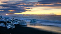 a real Song of Ice and Fire (lunaryuna) Tags: ocean light sea sky panorama sunlight cold nature beauty sunrise reflections landscape dawn coast iceland mood colours shore lunaryuna cloudscape iceflows northatlantic diamondbeach earlysunrise iceandfire glacialice southeasticeland lightmood blackvolcanicbeach thecoloursofcold jokulsarlonglacierlake