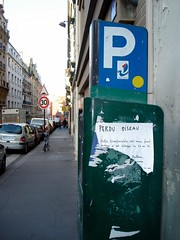 On the streets of Paris (toucanne) Tags: street paris poster pavement streetsign sidewalk daytime rue affiche trottoir