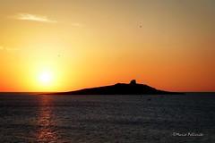The dark side of the island. :-) (Mario Pellerito) Tags: sunset sea sky italy canon dark island eos 50mm italia tramonto mare side 14 cielo sicily sole palermo italie sicilia isola sicilie isoladellefemmine 60d mariopellerito
